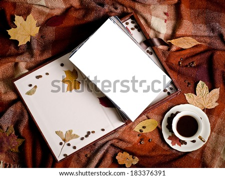 a pup of coffee and box with photo on brown plaid - stock photo