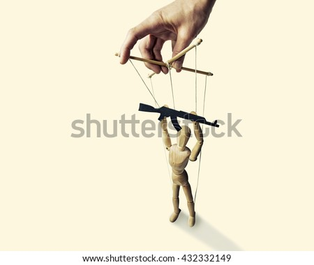 A puppet with  gun in the hands of the tyrant on the isolated toned background - stock photo