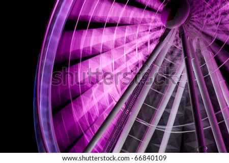 A Purple Ferris Wheel Is The Star Of A Entertainment Motion Picture, Reduced To One Frame - stock photo