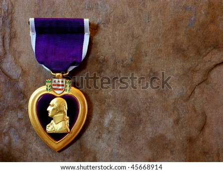 A Purple Heart Military Decoration Against a Slate Background - stock photo