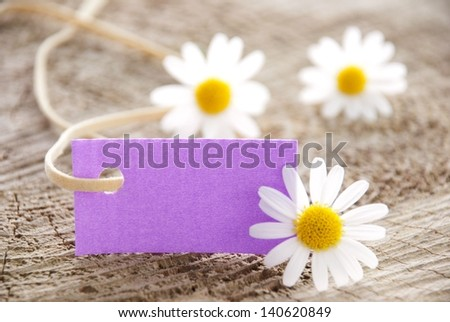 a purple label with white blossoms, copy space and background - stock photo