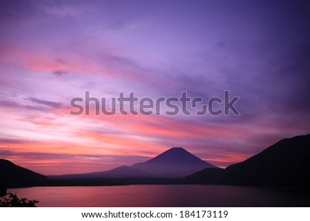 A purple night sky is above mountain tops. - stock photo