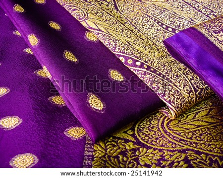 A purple saree folded in three with beautiful embroidery - stock photo