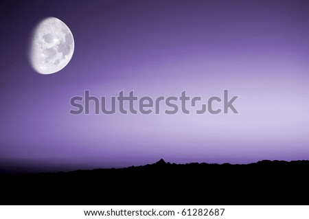 A purple sunset over the italian mountains with moon - stock photo