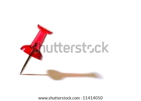 a push pin and it's shadow on white - stock photo