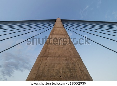 A pylon with supporting cable from a modern suspension bridge. - stock photo