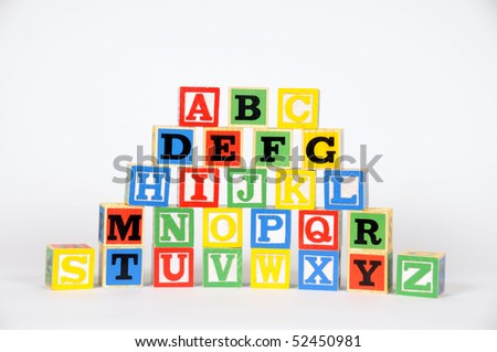 A pyramid of letter blocks spell out the alphabet - stock photo
