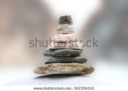 A pyramid of stones. Zen, serenity, balance. - stock photo