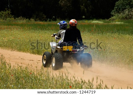 A quad bike ride in nature - stock photo