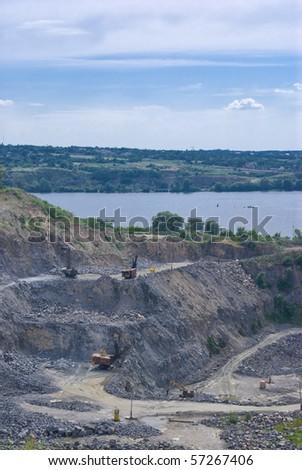 A quarry beside river. - stock photo