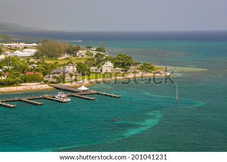a quiet marina and dock in falmouth, jamaica on the caribbean sea - stock photo