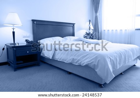 a quiet morning in a hotel bedroom - stock photo