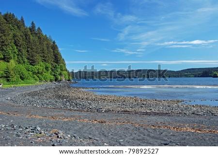 A quiet ocean cove on Kodiak island in the summer - stock photo