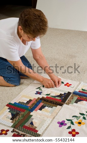 A quilter tags a panel of fabric prior to final assembly of the quilt.