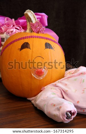 A quirky girl pumpkin looks at the camera - stock photo