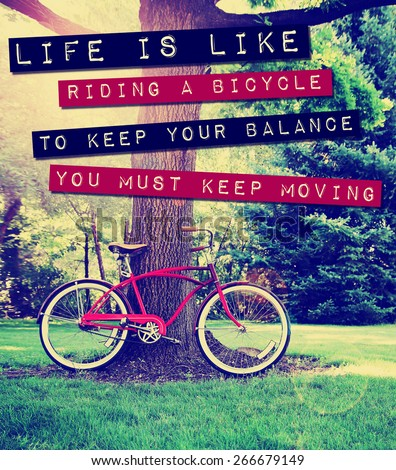 a quote: life is like riding a bike to keep your balance you must keep moving, over a bike photo toned with a retro vintage instagram filter app or action - stock photo