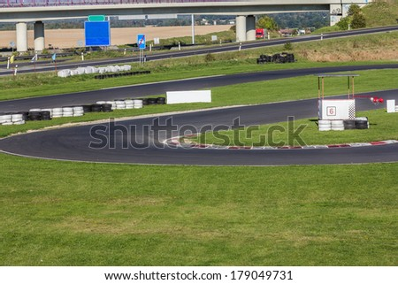 A racetrack close to a highway - stock photo