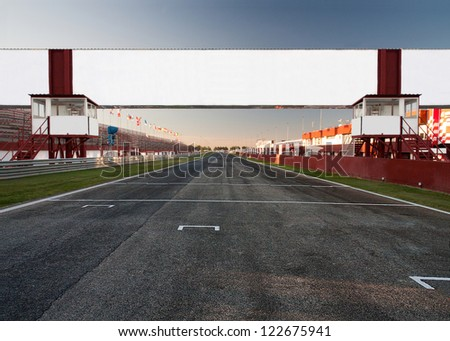 a racetrack with an empty board, for filling with text o logo. It can be used as conceptual business picture. Focus is on the board - stock photo