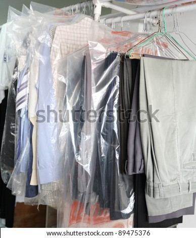 A rack of clean clothes awaiting collection from a laundry