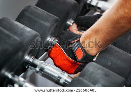 A rack with metal dumbbells in gym. - stock photo