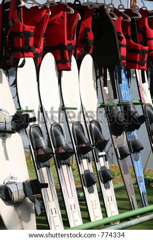 A rack with water-skiing boards and lifejackets.