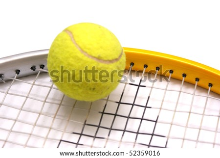 A racket and a tennis ball - stock photo