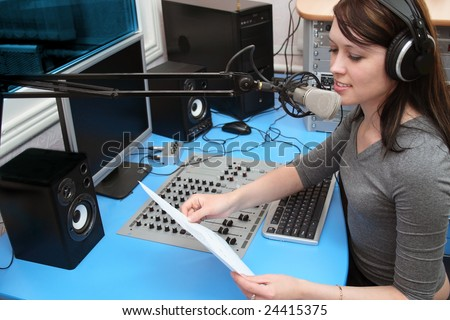A radio DJ announces news in a radio-studio - stock photo