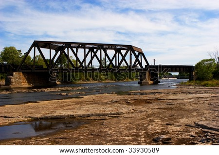 a Railroad bridge overlooking an almost dry riverbed of the Moira River in Ontario, Canada