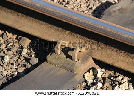 A Railway Track Chair Holding the Rail to the Sleeper. - stock photo