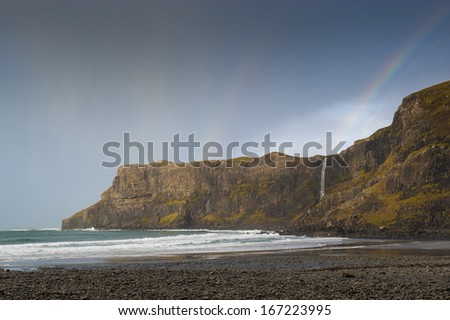 - stock-photo-a-rainbow-appearing-over-the-waterfall-on-talisker-bay-syke-on-a-stormy-winters-day-167223995