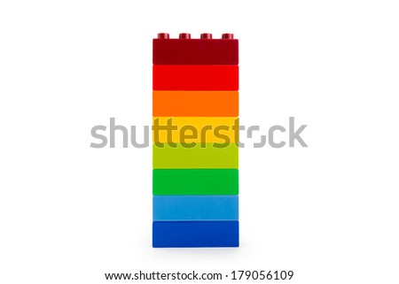 A rainbow color lego blocks on white background - stock photo