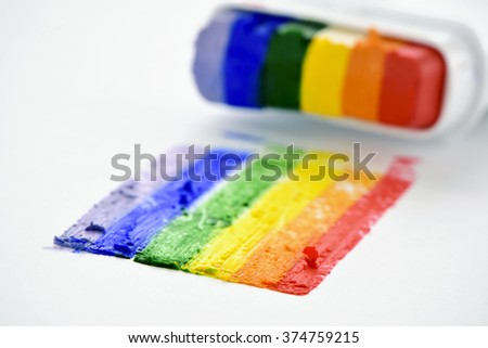 a rainbow flag painted in a white surface with crayons with the colors of the rainbow - stock photo