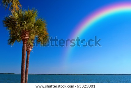 A rainbow over the ocean off St. Petersburg Beach, Florida after a storm moved though. - stock photo