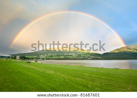 A rainbow over Voss city in Norway - stock photo