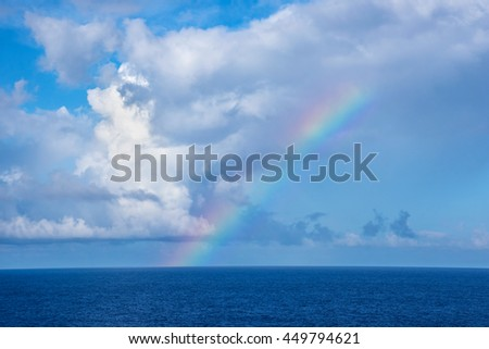 A rainbow view from a cruise ship in the North Atlantic. - stock photo