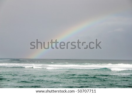 A rainbow view in Hawaii beach. - stock photo