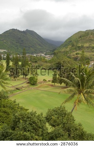 A rainy day causes this Honolulu Hawaii golf course to become deserted.
