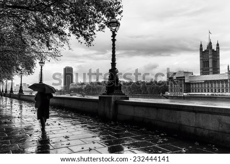 A rainy day on the South Bank of River Thames with Palace of Westminster in Background, London, England, UK
