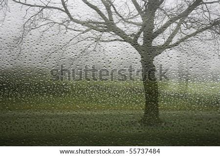 A rainy winter day seen through a wet window , Denmark. - stock photo