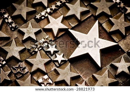 A random arrangement of letterpress stars with narrow depth of field, tinted Sepia tone. - stock photo