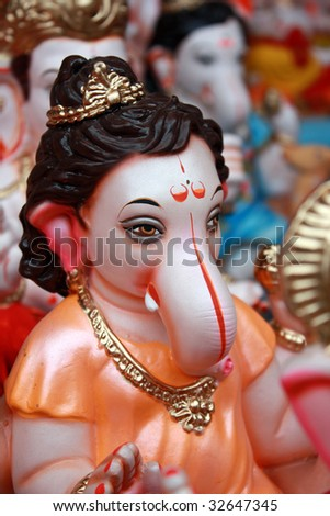 A rare idol of baby Lord Ganesha dressed up like sage Narad for sale in a shop.