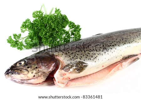 a raw trout on a white background