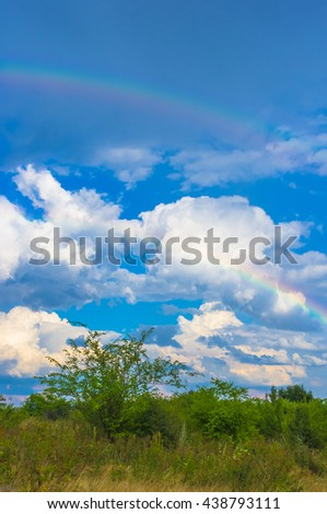 a real double rainbow over the Apple orchard - stock photo