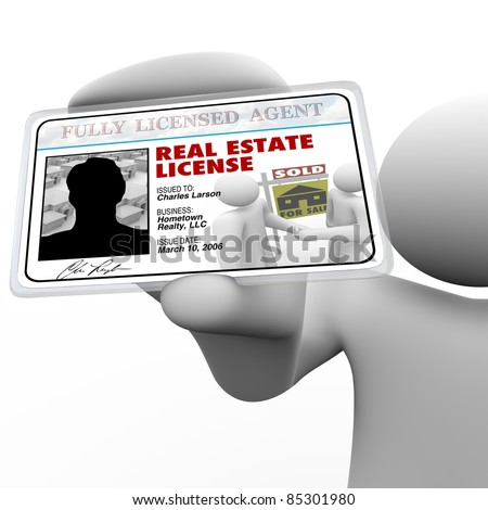 A real estate agent holds a laminated license proving he is certified and licensed by the proper authorities to do business in buying or selling property for you - stock photo