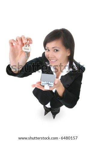 A real estate woman holding a key and house