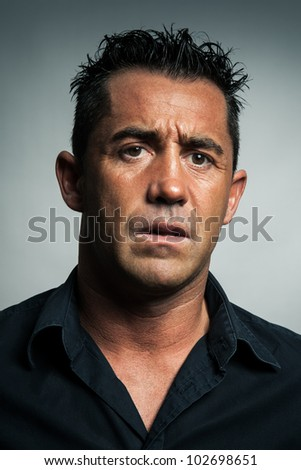 A real man is worried about something. - stock photo