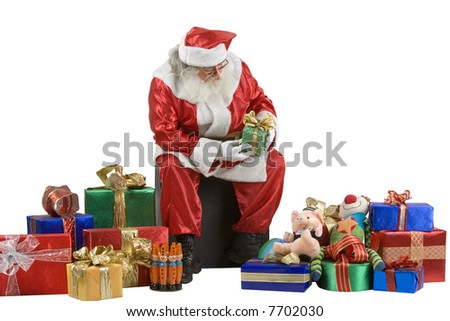 A real Santa Claus portrait taken at the South Pole checking presents - stock photo