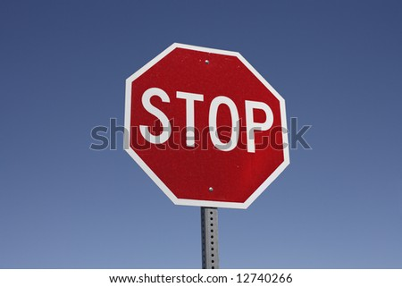 A real stop sign against a lovely blue sky.