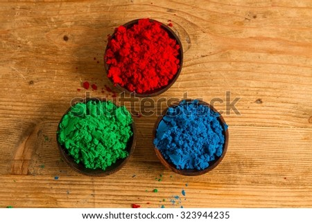 A real world rendition of the RGB subtractive colour system used in digital environments: red, green and blue powder pigments. - stock photo