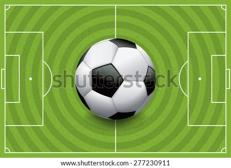A realistic football / soccer ball on a textured grass playing field. - stock photo